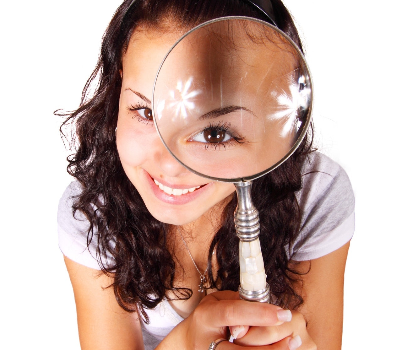 Girl Holding a Magnifier Searching for Quality
